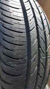 Quatre pneus d'été continental 215 55 16 comme neufs