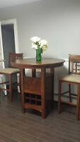 Solid Oak Pub table and two chairs