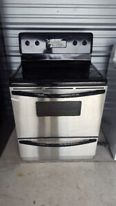 Stainlesssteel ceramic top selfcleaning stove and white fridge