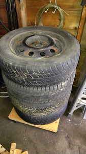 """Four 15"""" rims - 4 bolt pattern - with tires"""