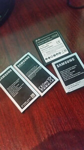 Spare Galaxy S3, S4, and 2 S5 batteries.