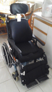 Tilt and reclining wheelchair