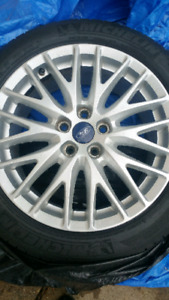 OEM Ford Focus rims with tires 215/50R/17 set of four