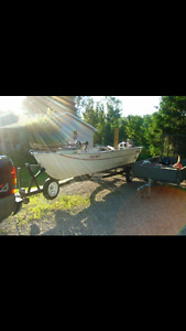 16 foot Grumman boat with a 20 hp Johnson  cash or trade