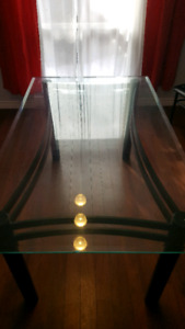 Glass topped 6 person dining table