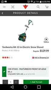 Brand new Yard Works electric snow blower with extension cord