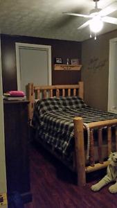 Custom double log bed frame