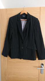 Women's three piece black pinstripe suit
