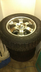 Awesome Mikey Thompsons tires and rims GMC Chev 275/65/20