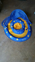 FLOTATION DEVICE FOR BABIES WITH COVER FROM SUN
