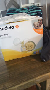 Medela Breast Pump with extra attachments (NEW)