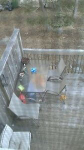 Glass top patio set with 3 chairs