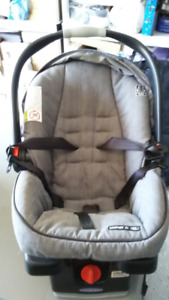 two baby car seats with snap in base