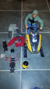 Toy Snowmobile with man & accessories & sound and motion