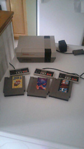 Original nes with  3 games and 3 controlers