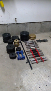 Weights and Dumbbell handles.  320 lbs Total @ .75$