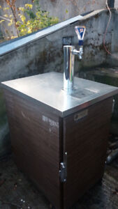 S/S steam table with 2 warming ovens and draft beer dispenser.