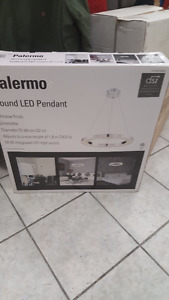 New in box Palermo round led pendant light.