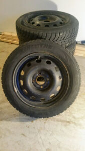 4 Winter Radial Tires on Wheels for 2005 Ford Focus or Similar