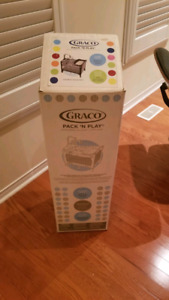 Like new Graco playpen with changer and mobile