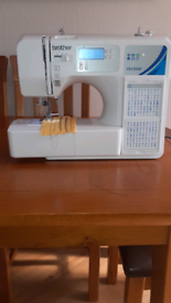 BROTHER FS130QC SEWING MACHINE AND STORAGE TROLLEY.