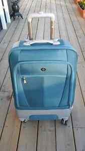Like new. Blue 24 inch spinner suitcase
