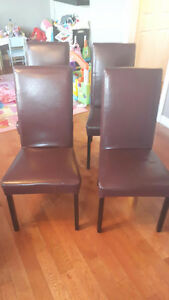 4 plum color leather look chairs in good shape