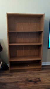 Bookshelf, rich brown / orange, with three adjustable shelves.