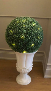 Beautiful green sphere urns with lights