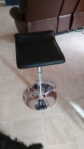 Metal and black stools