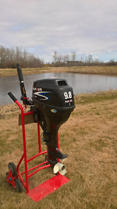 9.8 4 stroke outboard. Short shaft. Mint. About 20 hrs on it.