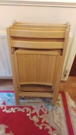 Four folding wooden chairs excellent condition