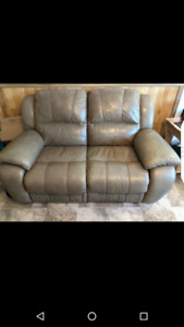 Recliner leather couch set.  3 piece