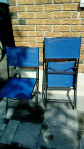 Two blue folding chairs