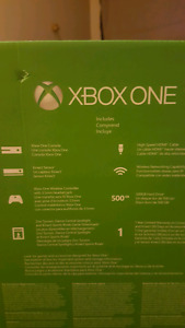 Xbox One 500gb  + 2 controllers and 5 games $300  firm!