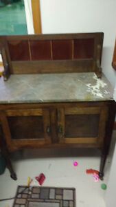 Cabinet with granite top.