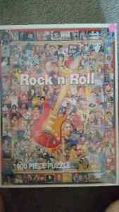 Factory sealed 1000 piece rock and roll puzzle only $15.........