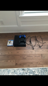 Sony PS4 with two controllers and NHL 15 game