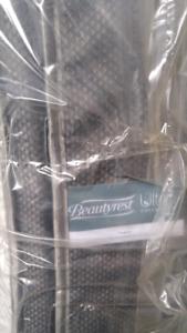 Brand new pillowtop  Queen mattress.  Still in plastic .