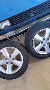 Set of 4 used Mazda summer tires with rims