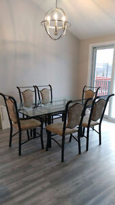 Glass Dining Table with 6 Cushioned Chairs