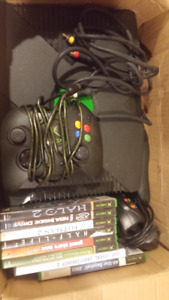 Xbox with 2 controllers and 8 games