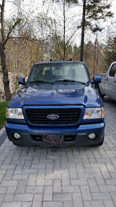 2009 Ford Ranger Pickup Truck with Plow and winter tires on rims