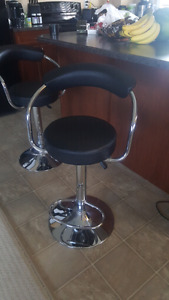 2 Like-New Adjustable Bar Stools