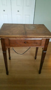 Wood Table containing Vintage Sewing Machine