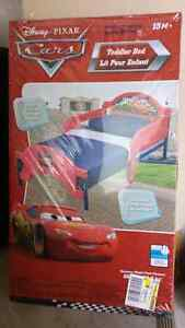Brand new never opened Disney Cars Toddler Bed $65