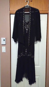 Jolie robe porter 1 seule fois..payer 320$ je la vend 150.00