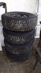 215 70 15  4 Hankook I pike, studded winter tires on rims