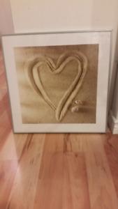 Pretty heart in sand picture