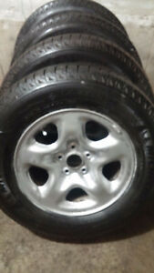 Like new 4 Michelin Latitude 225 70 16 tires on Rav4 steel rims